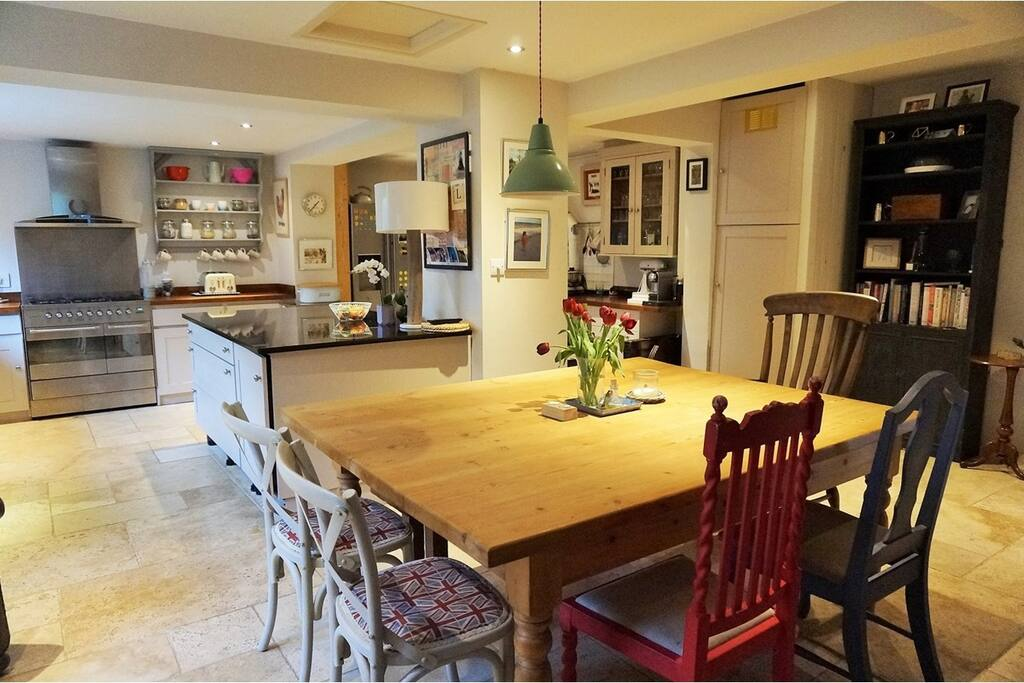 Kitchen/diner with Aga and separate cooker and access to our tropical garden!