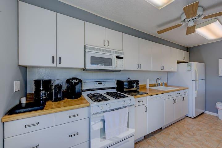 Kitchen area, gas stove, dishwasher, refridgerator, microwave, toaster, Kuriege coffee maker, expresso/cappicino machine