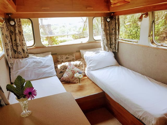 Caravan can be made up as two single beds (slightly shorter than standard beds) or as a double bed