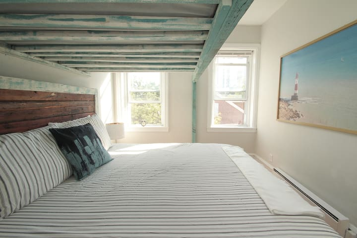 """King size bed w/ high end mattress  """"The place had everything I needed (including an iron for my suit!) and the world-traveler-themed decor was beautifully done."""""""