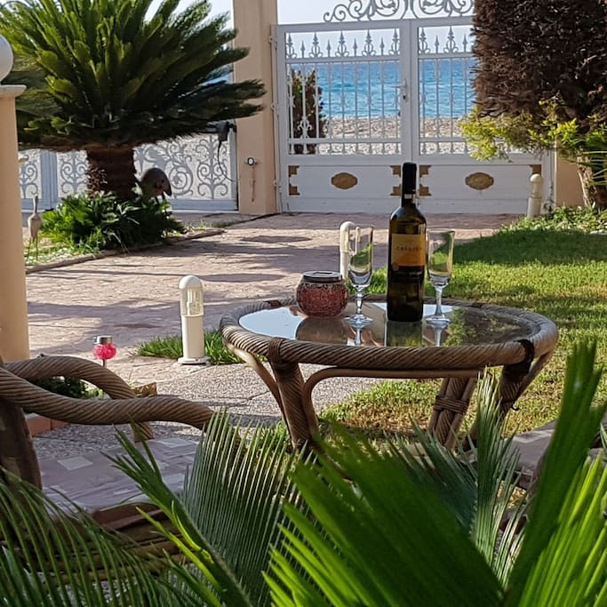 Enjoy sitting under the umbrella in the garden, sipping wine just a stones throw away from the beach.