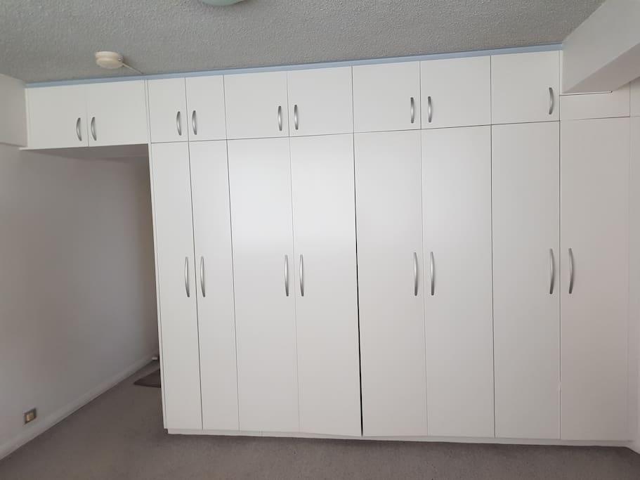 Storage cupboards bed inside, hallway to separate kitchen & bathroom