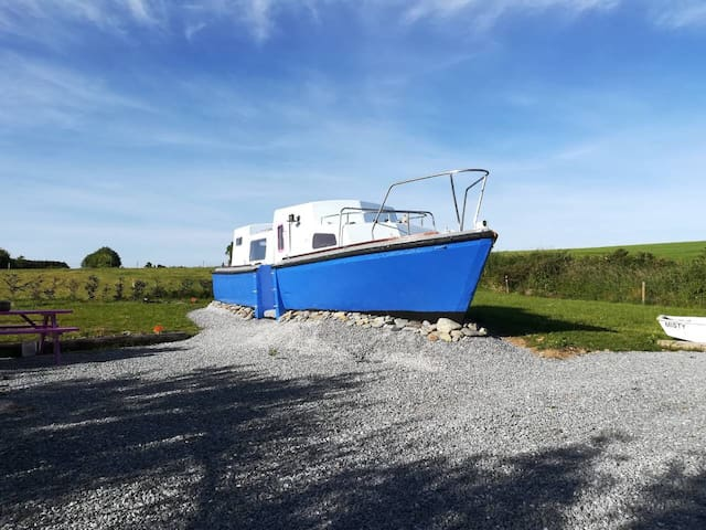 Quirky land boat close to the beach with donkeys!