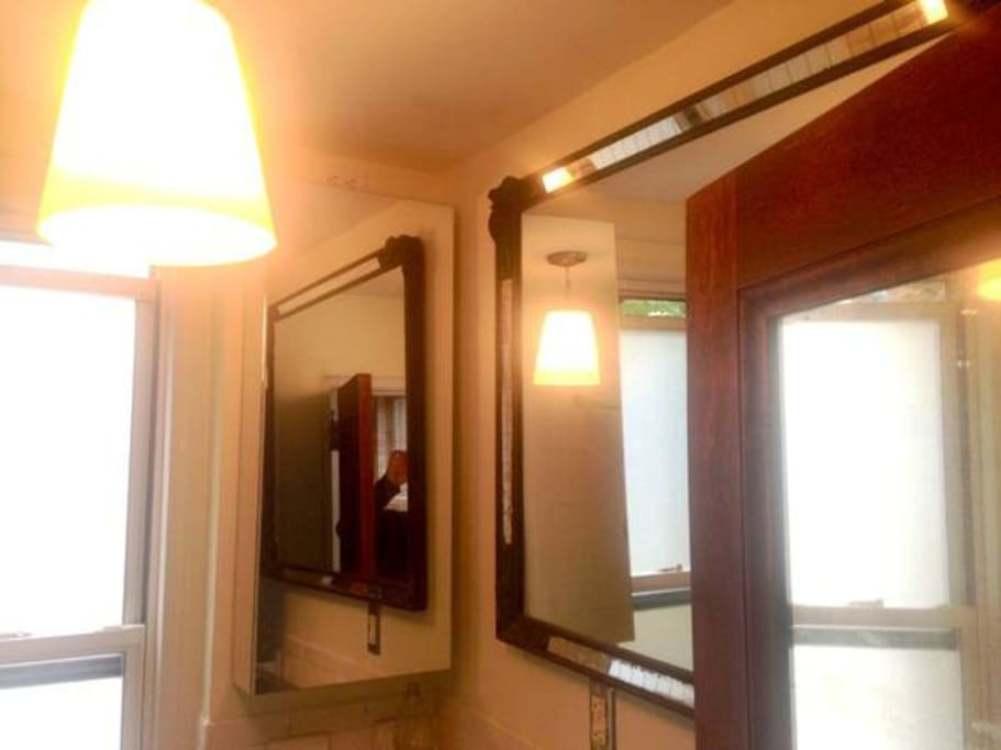 in small apartments, mirrors are a good way to make the space look bigger.