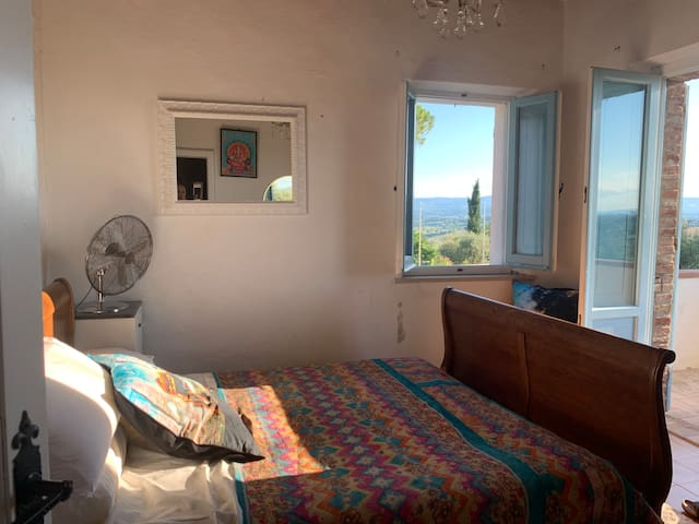 Charming bedroom with views over Umbria and Tuscany from balcony