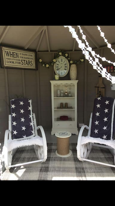 Relax in our wee summer house with a drink and enjoy the stars or sunshine whilst reading a book .