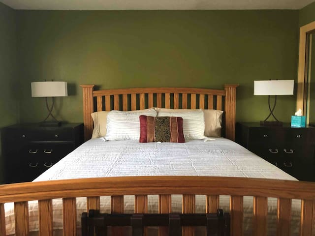 MASTER BEDROOM with California King bed, double dressers and lamps with easy access plugs for electronics