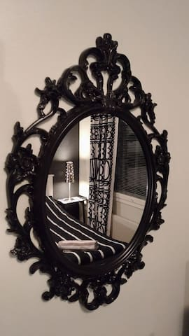 The room is beautiful and it is in black and white style.