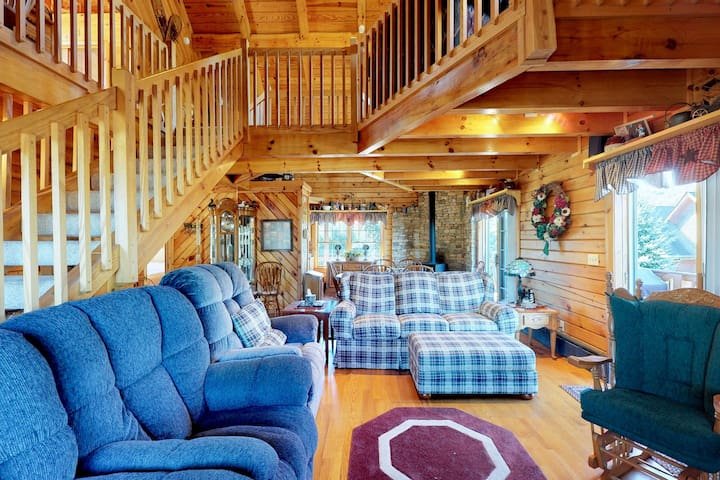 Dog-friendly home w/ wrap-around deck, shared dock & lake views!