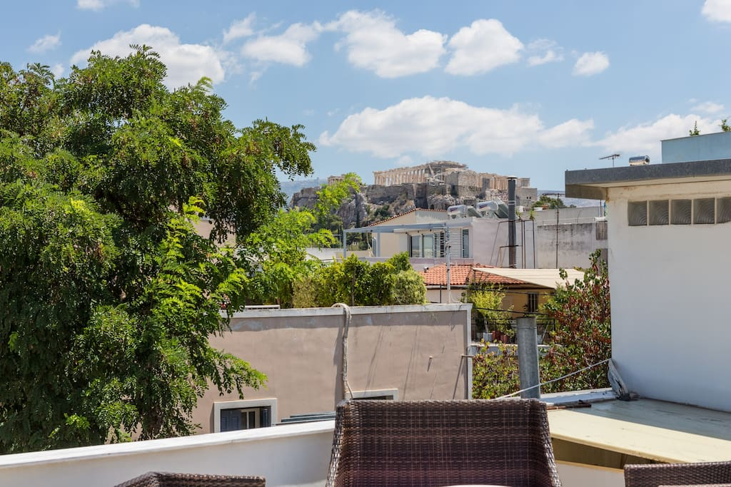 Roof garden available a with view towards Acropolis from one side, Filopappos Hill to the other