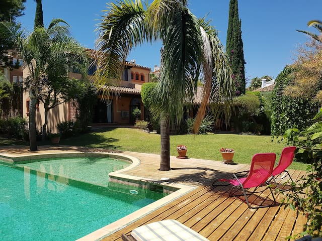 Family-friendly villa with large pool and garden