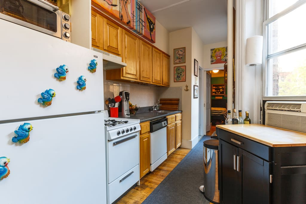 Kitchen with dishwasher, toaster oven, and collection of ceramic woodland creatures to gaze upon