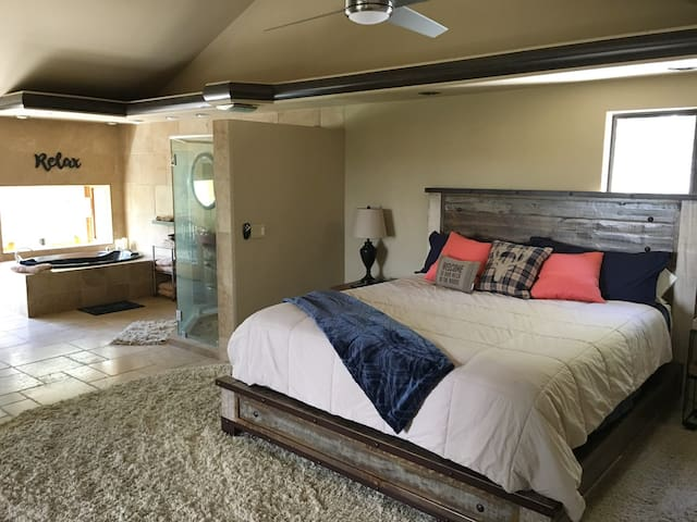 """The loft-style master suite covers the whole top floor with an open master bath and two balconies. New hybrid memory foam King bed with an adjustable base for taking in the view or reading your new favorite book.  Bonus 55"""" mounted HDTV. Get cozy!"""