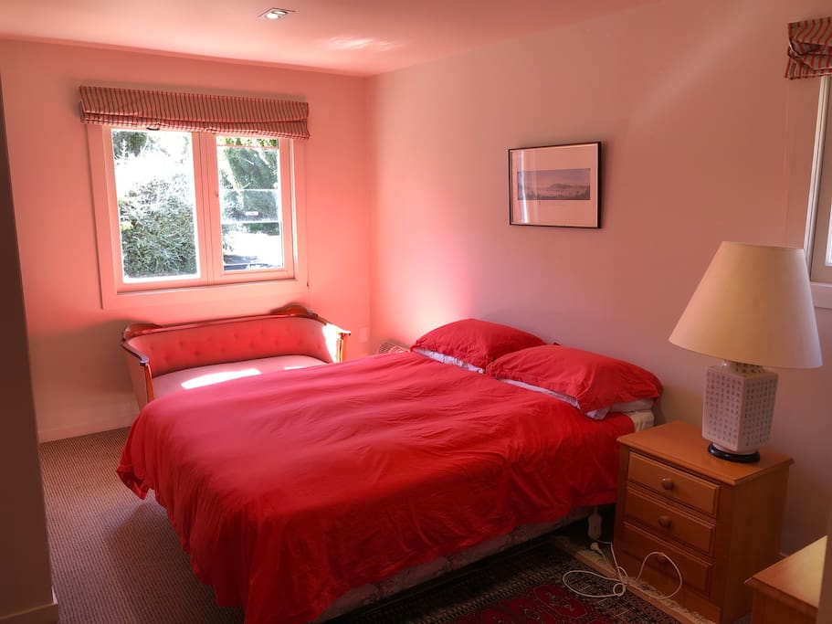 One of three bedrooms, two with adjoining bathrooms