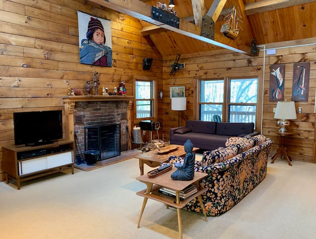 Family room w/ fireplace & cable TV.