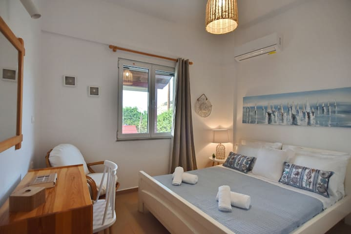 bedroom with double bed and sea view