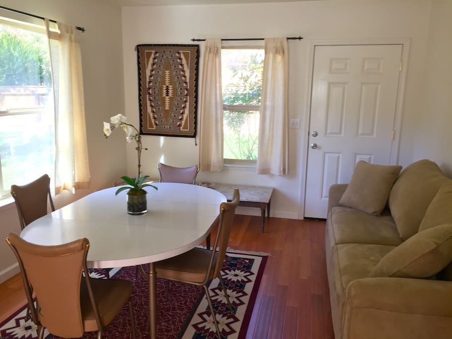 Living area with couch and dining table.