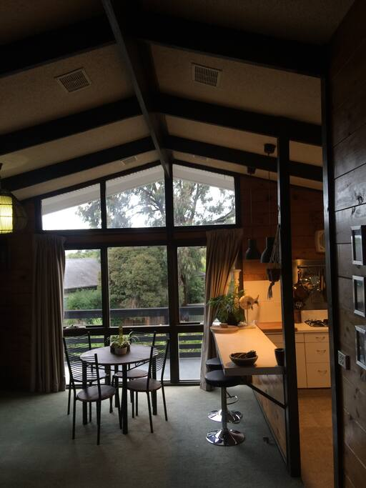 Tree top and filtered water views from open plan upstairs living