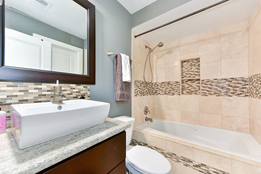 Lovely modern bathroom complete with soaking tub