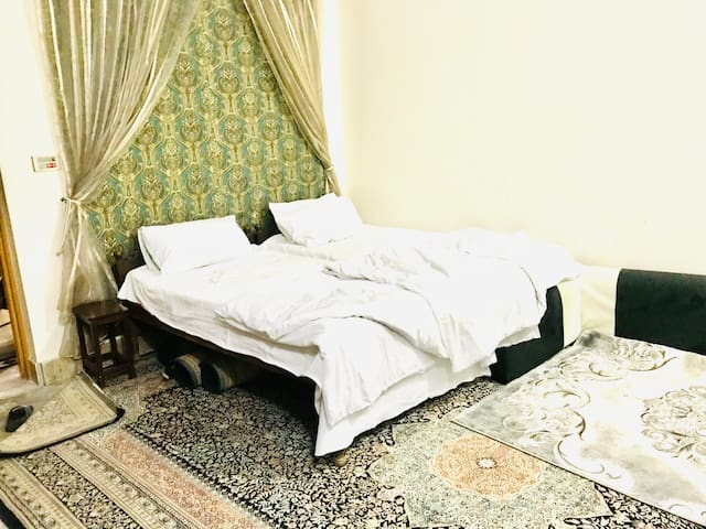 Bed room of 2 single beds with attached bath