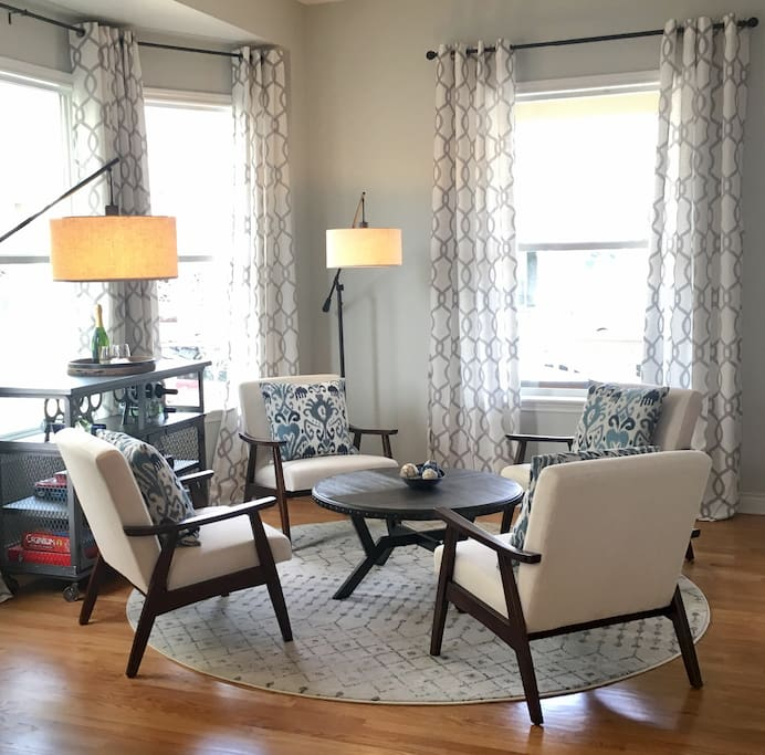 Sunny living room. Enjoy a cup of coffee in the morning, and gather the family for a card game in the evening.
