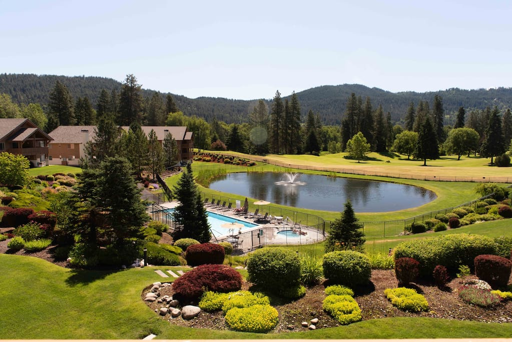 Taken from private deck, heated pool and hot tub are just steps away.  Watch the golfers go by, and the ducks and geese float along the fishing pond.