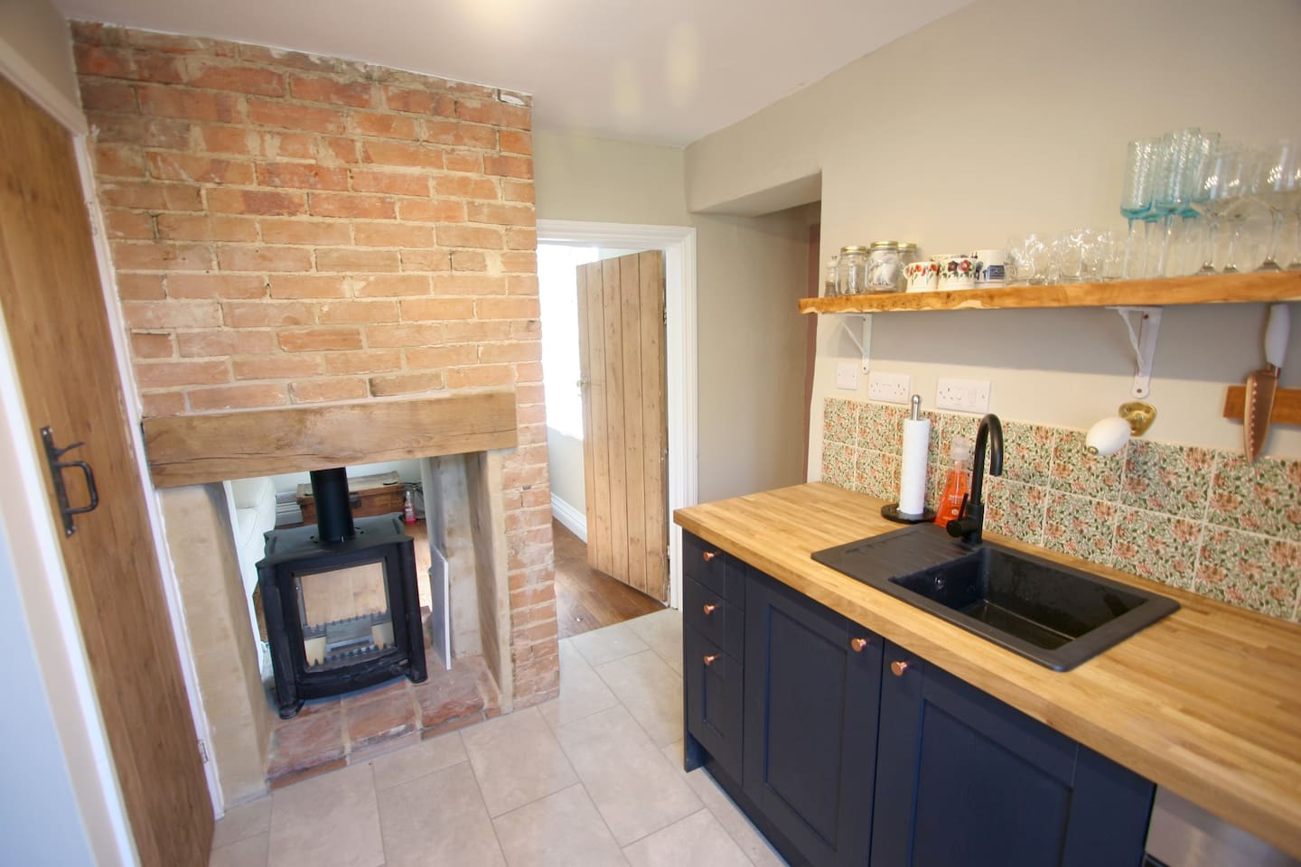 Brand new fitted kitchen, double sided wood burner and exposed brick fireplace