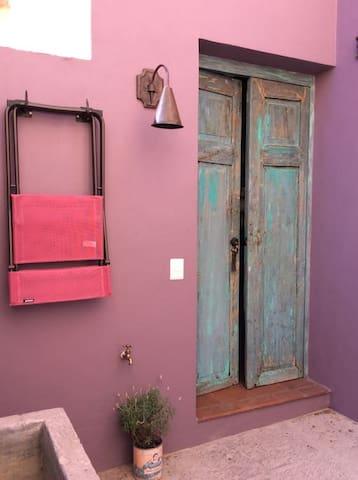 Enter through antique Mesquite Doors