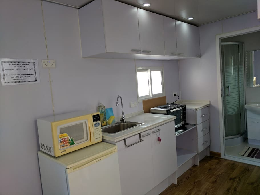Kitchen with Microwave, Fridge, Cooktop