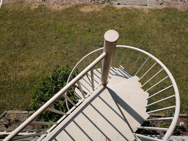 Spiral staircase leading to the dock
