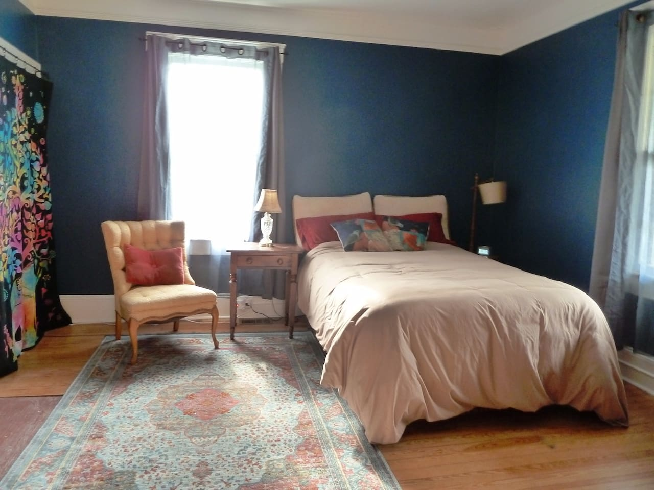 Spacious and comfortable bedroom.  Relaxing deep blue walls.