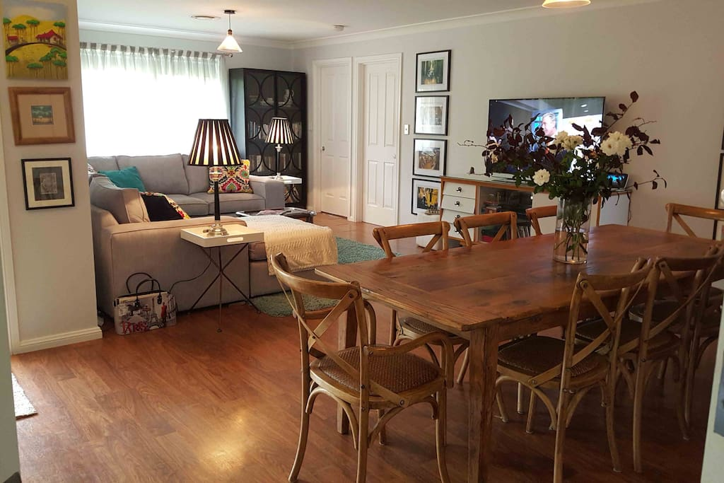 Dining table seats 8 comfortably. Side dresser has a huge range of serving plates for family get togethers.