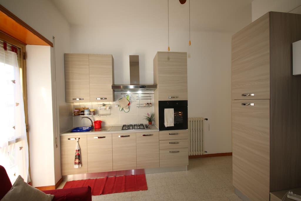 Fully equipped Kitchen/Dining room  with ceiling fan and 3 seater lounge.