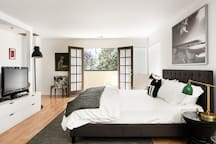 Master suite with king bed /cotton linens opens to private deck with views of the Getty Museum