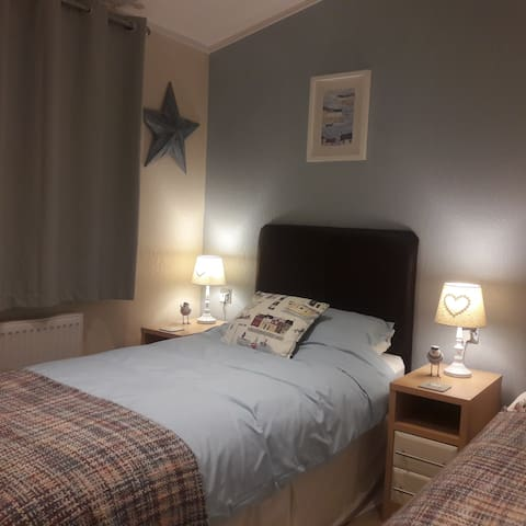 Twin room with 2 single beds.   Our zedbed or travel cot also fits within this room.  Please enquire when booking.