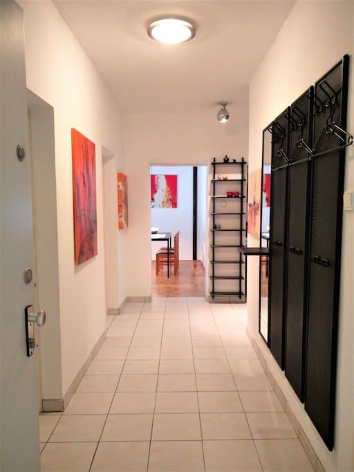 Vorzimmer /  Spacious hallway lined with artwork by Annemarie leads to a lovely large living room with a balcony over looking a beautiful park