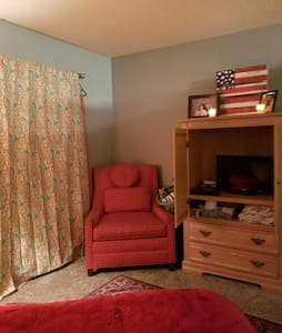 Living room set up for two, privacy curtains.