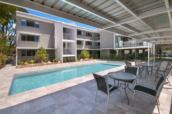 Jacaranda Noosa heated swimming pool with sun lounges, electric BBQ and seated dining