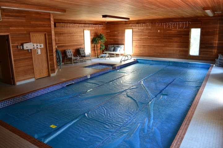 Heated indoor pool and spa! Swim in lovely warm water or relax in comfy garden chairs close by. Change-room with shower and plenty of towels!
