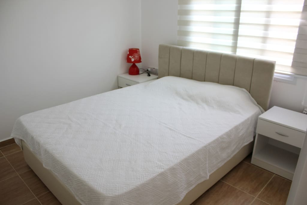 The bed in bedroom