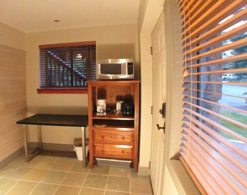Kitchenette with microwave, toaster, coffee maker and fridge (not in photo)