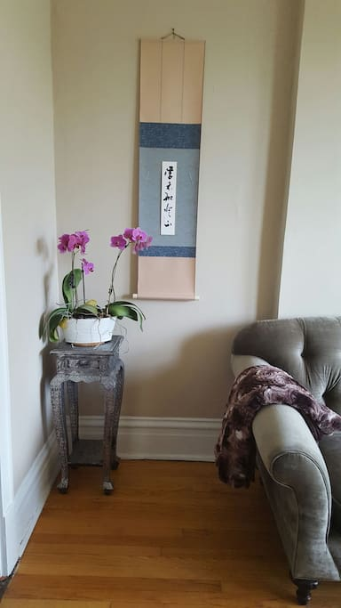 Orchids and Japanese scroll in the living room