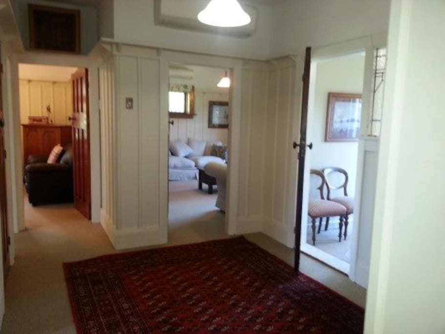 Hall showing two living rooms and small front bedroom