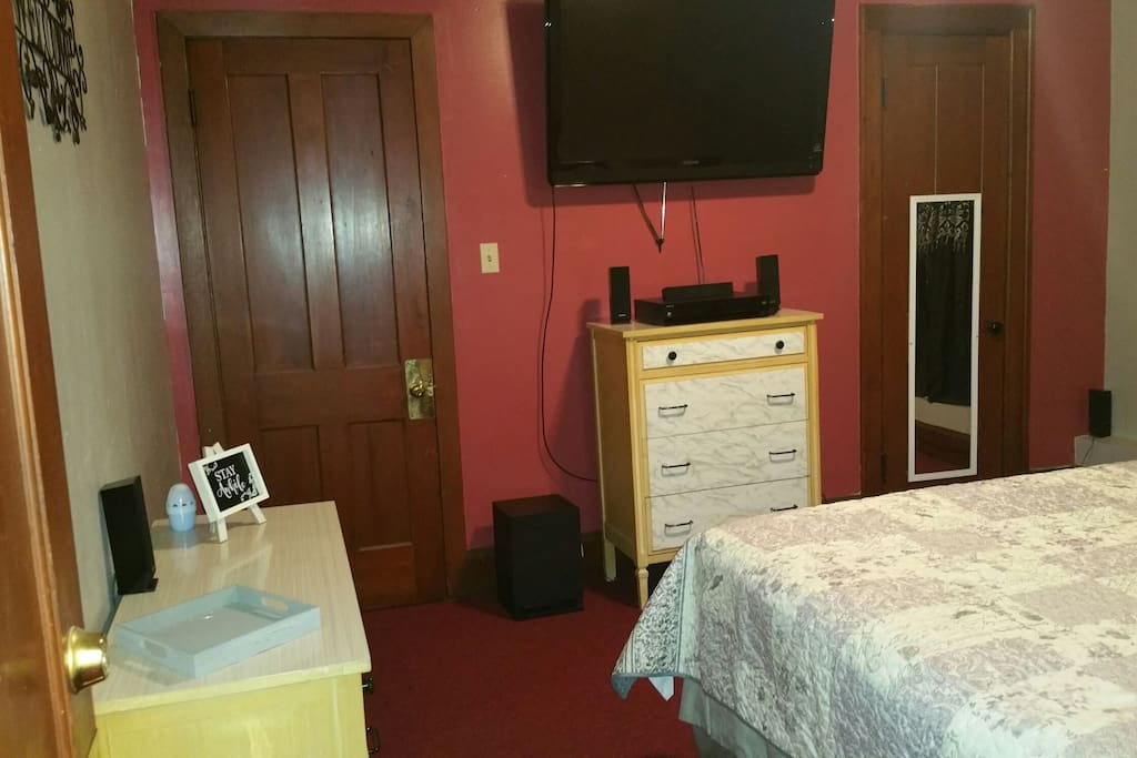 TV, Dresser and the door that leads to adjoining room...