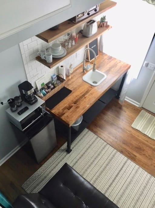 Kitchen area - coffee maker, microwave, refrigerator, toaster.