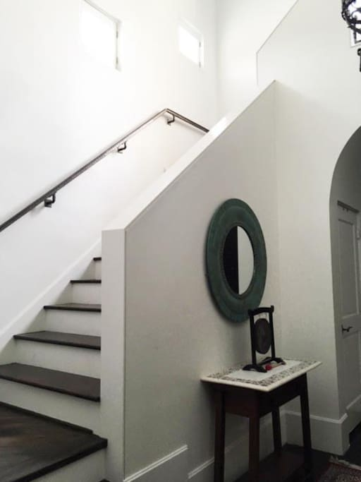 Shared foyer with a view to the staircase leading to your apartment
