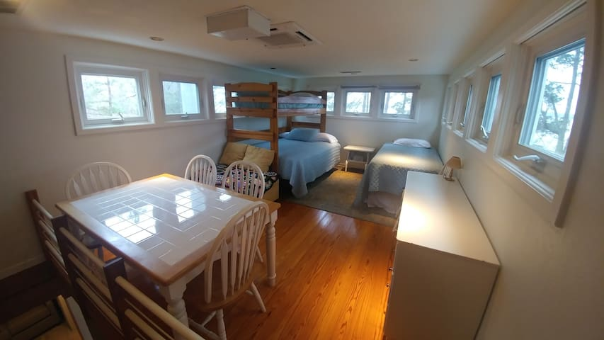 Loft area on third floor with two twin size beds and one full size bed
