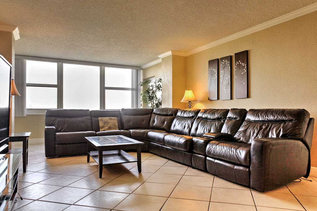 A leather sectional sofa invites you to sit back and relax.