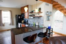 Fully equipped kitchen with seating.