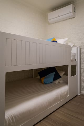 Bedroom 2 featuring the king single bunks. These beds are super comfortable with hotel quality linen. Bedroom 2 also features a convenient of a wardrobe with hanging and draw space.